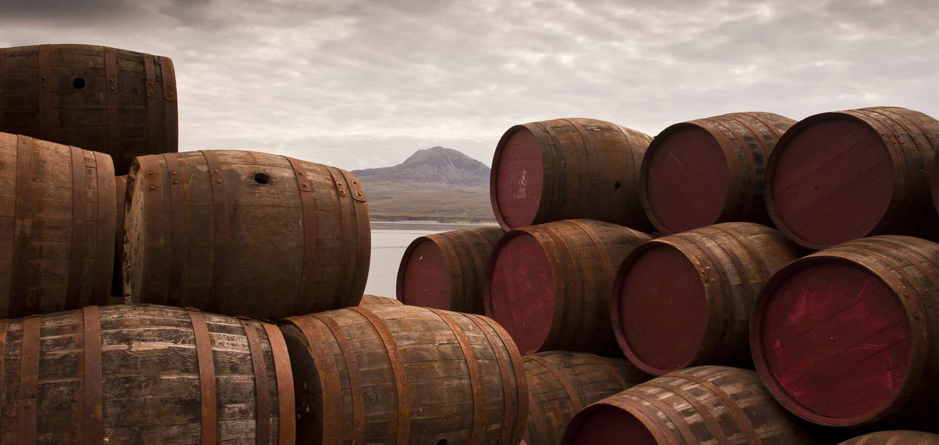 Whisky Barrels with Scottish Mountain Background